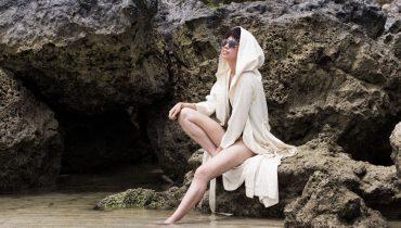 One-shoulder swimsuit & Ayurganic bathrobe by Alice M. Huynh
