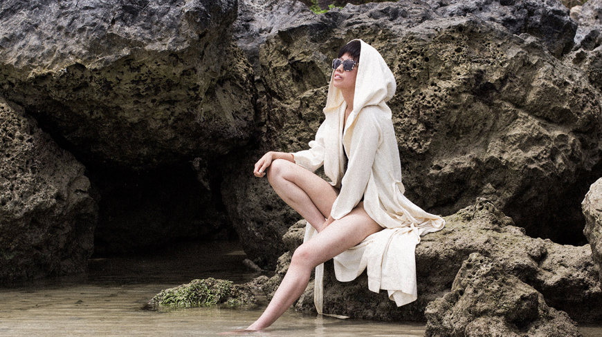 One-shoulder swimsuit & Ayurganic bathrobe by Alice M. Huynh
